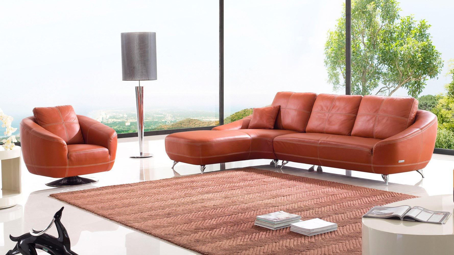 Orange lucy leather sectional sofa zuri furniture for Chaise orange