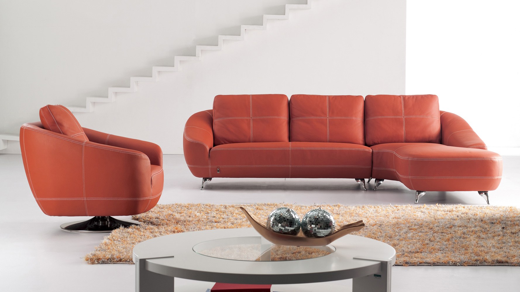 orange lucy leather sectional sofa zuri furniture. Black Bedroom Furniture Sets. Home Design Ideas