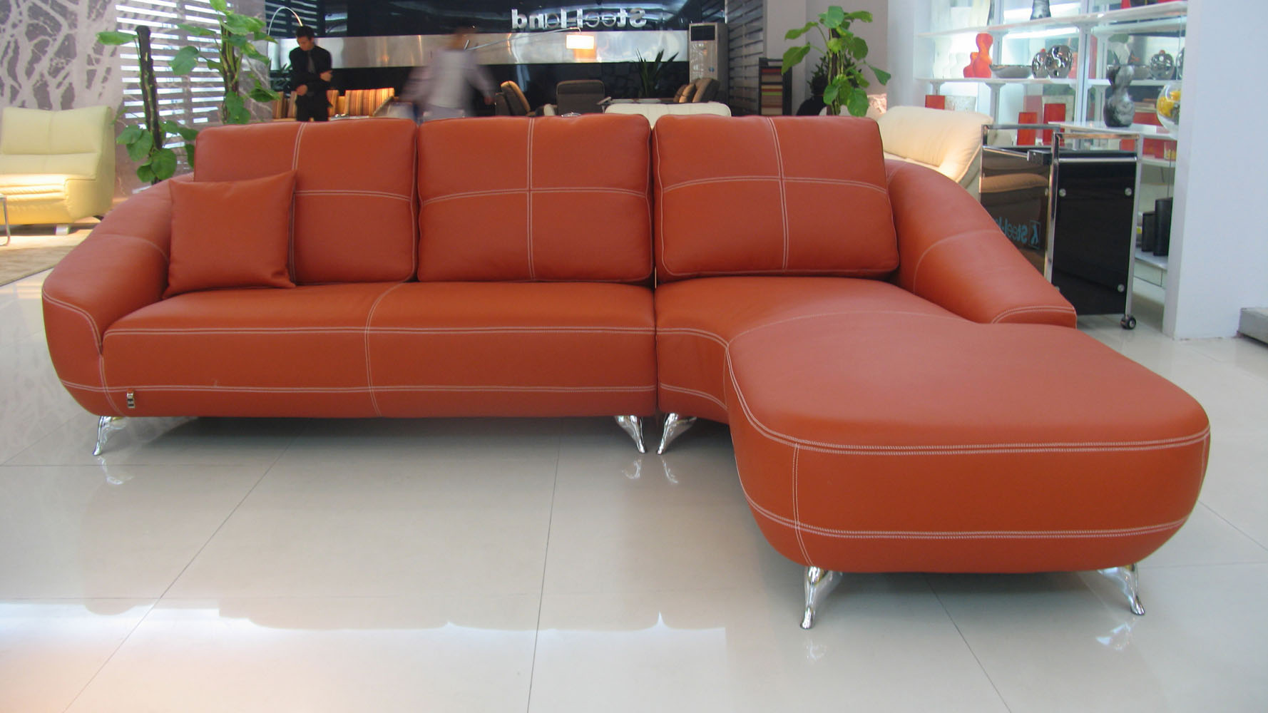 orange lucy leather sectional sofa zuri furniture. Black Bedroom Furniture Sets. Home Design Ideas