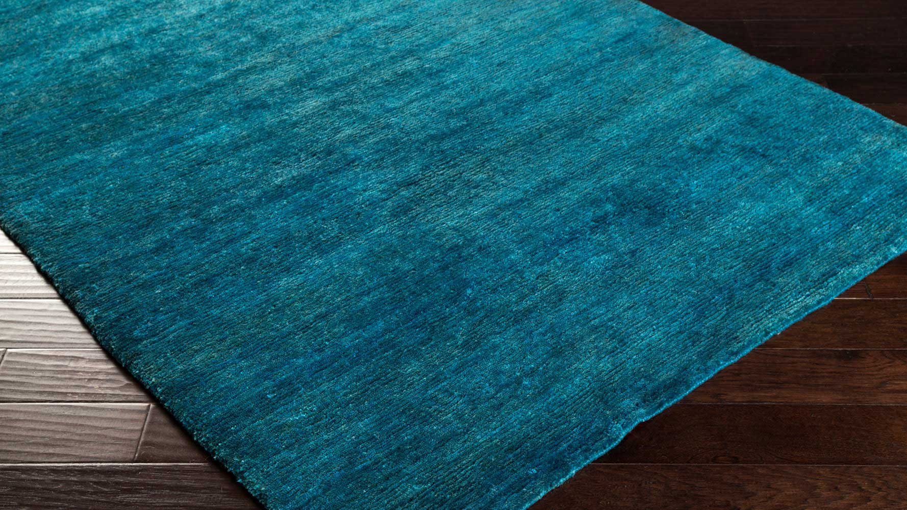 Hand Knotted Crusoe Area Rug Teal Zuri Furniture