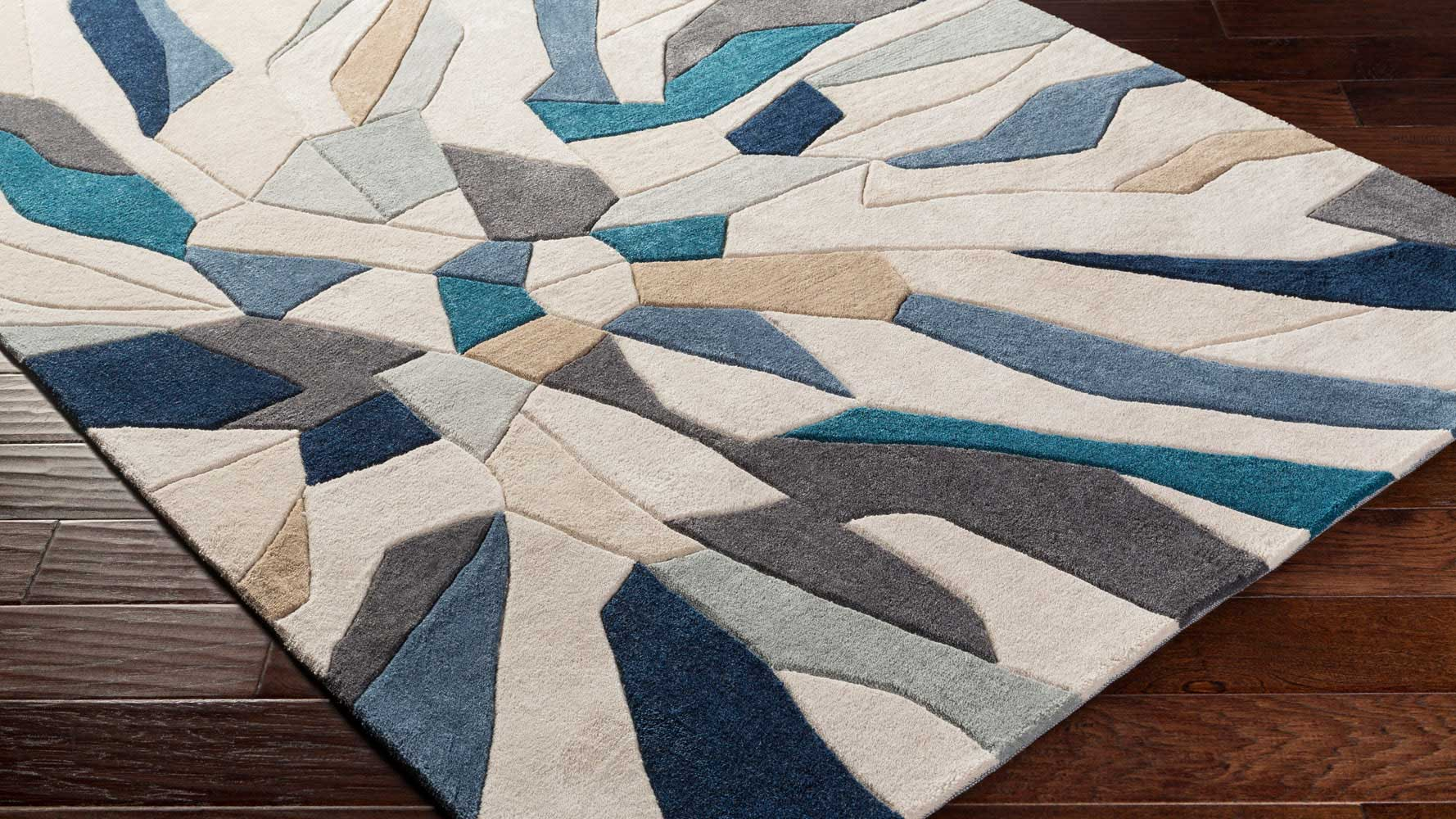 hand tufted cosmopolitan area rug teal navy zuri furniture
